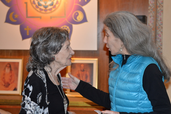 96-year-old yoga master Tao Porchon-Lynch with Molly Heron at Integral Yoga Institute