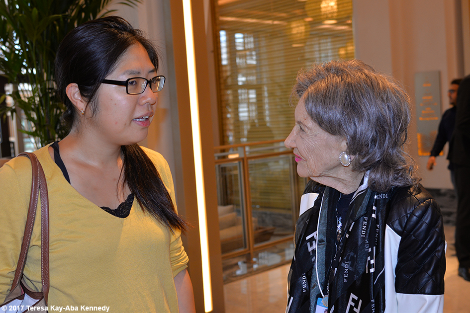 98-year-old yoga master Tao Porchon-Lynch with new friend in lobby of Jumeriah Al Naseem in Dubai - February 11, 2017