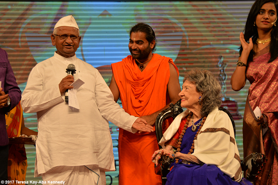 Anna Hazare, Shwaasa Guru and 98-year-old yoga master Tao Porchon-Lynch receiving Yoga Ratna Award in Bangalore, India - June 20, 2017