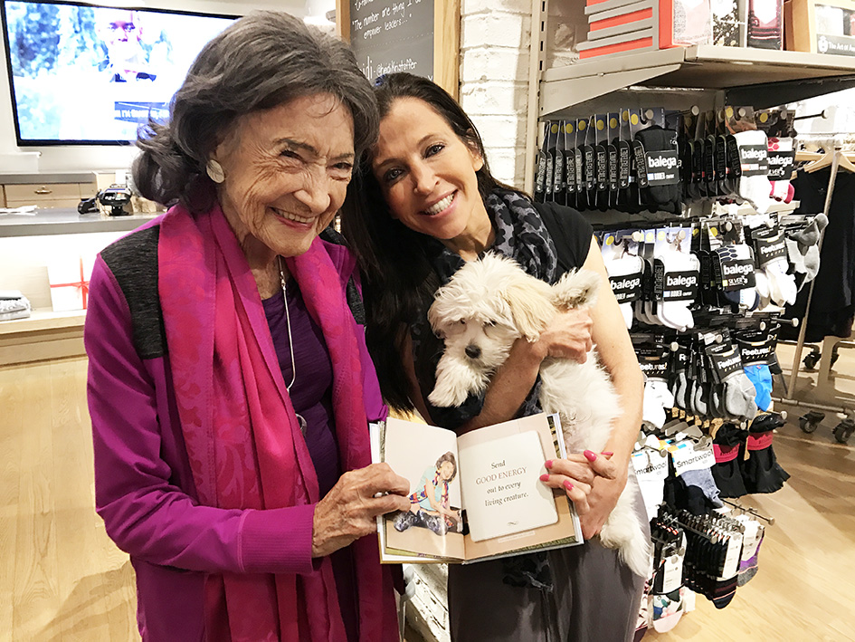 99-year-old yoga master Tao Porchon-Lynch with Wendy Diamond and her dog at the Athleta store - November 18, 2017