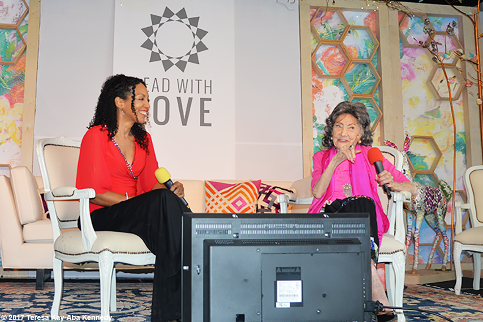 99-year-old yoga master Tao Porchon-Lynch and Teresa Kay-Aba Kennedy during Conversation with a Master at the Lead With Love Conference in Aspen, Colorado – October 26, 2017