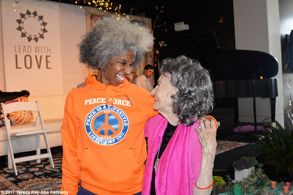 Erica Ford and 99-year-old yoga master Tao Porchon-Lynch at Lead With Love Conference in Aspen, Colorado – October 27, 2017