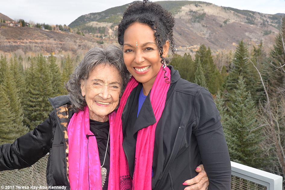 99-year-old yoga master Tao Porchon-Lynch and Teresa Kay-Aba Kennedy at Lead With Love Conference in Aspen, Colorado – October 27, 2017
