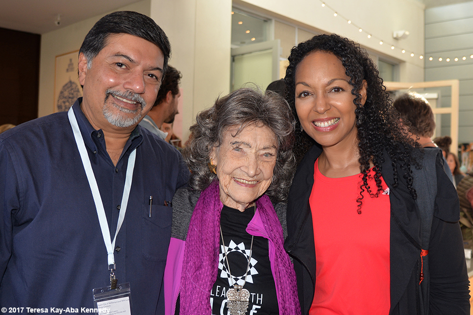Raj Sisodia, 99-year-old yoga master Tao Porchon-Lynch and Teresa Kay-Aba Kennedy at Lead With Love Conference in Aspen, Colorado – October 28, 2017