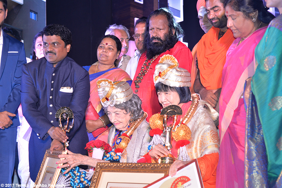 98-year-old yoga master Tao Porchon-Lynch receiving award in Bangalore, India - June 19, 2017