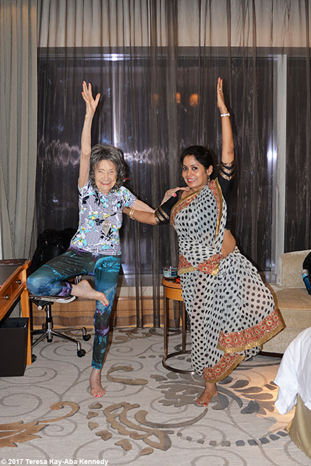 98-year-old yoga master Tao Porchon-Lynch and Anuradha Prabhu doing yoga after the award ceremony in Bangalore, India - June 19, 2017