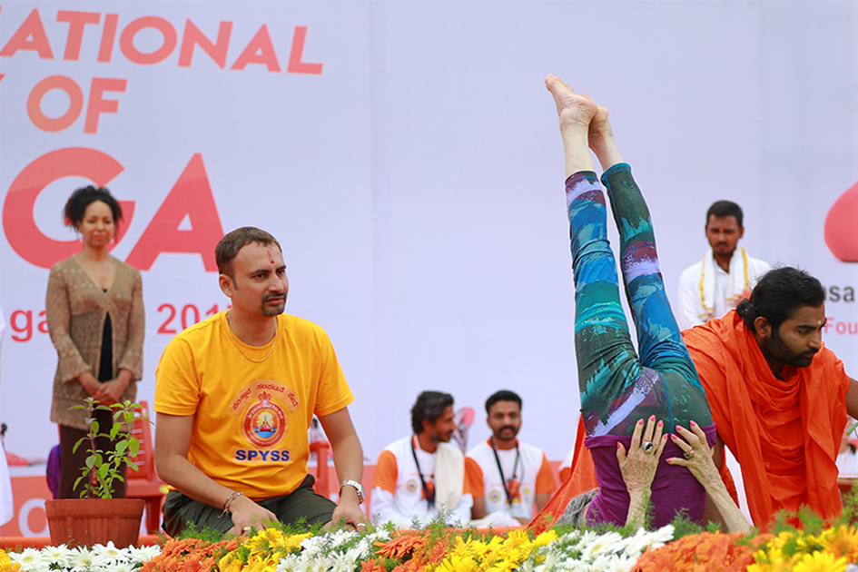 98-year-old yoga master Tao Porchon-Lynch demonstrating yoga on stage at International Day of Yoga at Kanteerava Outdoor Stadium in Bangalore, India - June 21, 2017