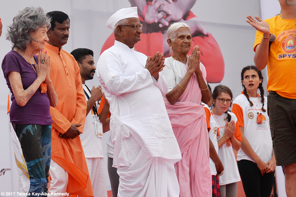 98-year-old yoga master Tao Porchon-Lynch, peace activist Anna Hazare and 97-year-old Amma V. Nanammal on stage at International Day of Yoga at Kanteerava Outdoor Stadium in Bangalore, India - June 21, 2017
