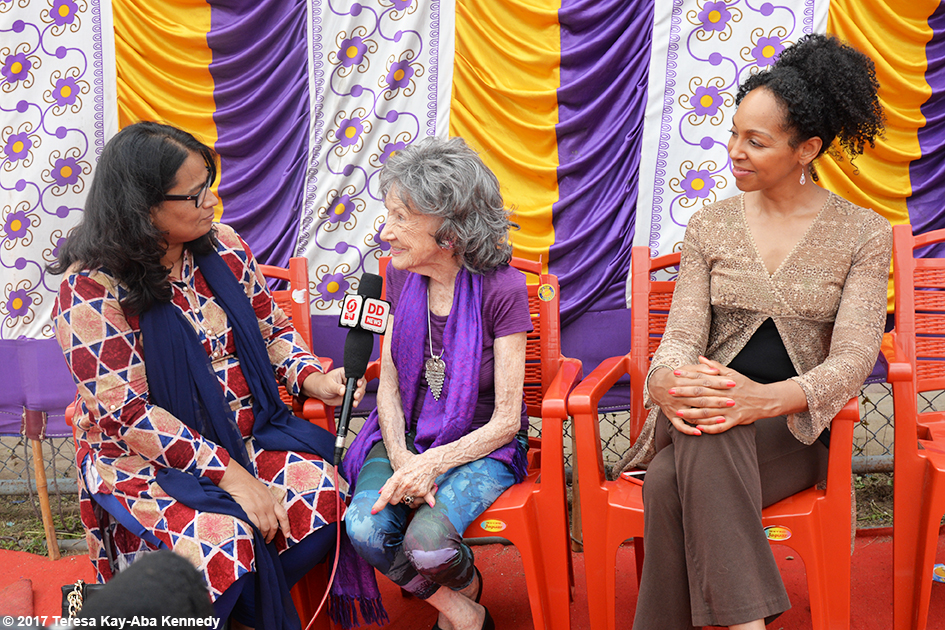 98-year-old yoga master Tao Porchon-Lynch doing media interview with Teresa Kay-Aba Kennedy watching for International Day of Yoga at Kanteerava Outdoor Stadium in Bangalore, India - June 21, 2017