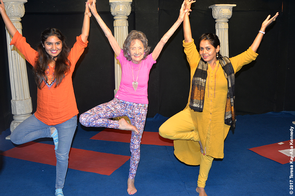 98-year-old yoga master Tao Porchon-Lynch with Nimma Seenu and Anuradha Prabhu doing yoga on the set of TV9 in Bangalore, India - June 21, 2017