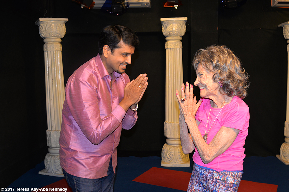 98-year-old yoga master Tao Porchon-Lynch and the host of TV9 in Bangalore, India - June 21, 2017