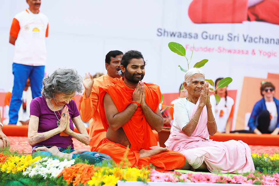 98-year-old yoga master Tao Porchon-Lynch, Shwaasa Guru and 97-year-old Amma V. Nanammal on stage for International Day of Yoga at Kanteerava Outdoor Stadium in Bangalore, India - June 21, 2017