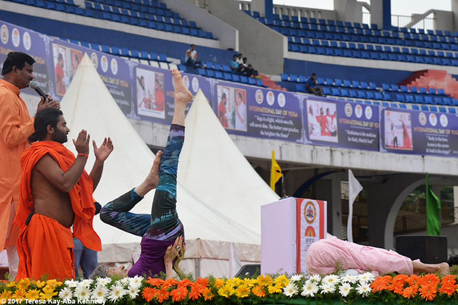 98-year-old yoga master Tao Porchon-Lynch and 97-year-old Amma V. Nanammal demonstrating yoga on stage at International Day of Yoga at Kanteerava Outdoor Stadium in Bangalore, India - June 21, 2017