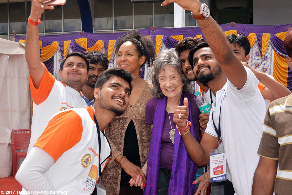 98-year-old yoga master Tao Porchon-Lynch and Teresa Kay-Aba Kennedy with Tao fans during International Day of Yoga at Kanteerava Outdoor Stadium in Bangalore, India - June 21, 2017