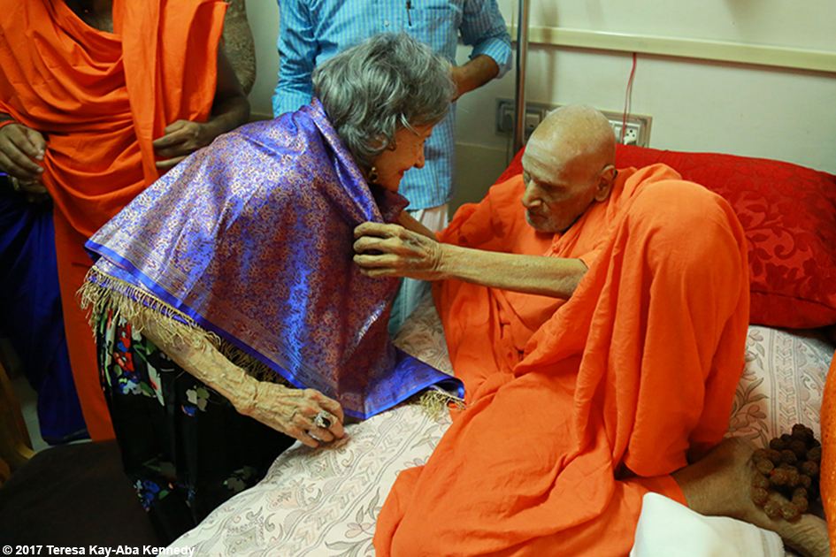 98-year-old yoga master Tao Porchon-Lynch receiving a blessing from 110-year-old Shivakumara Swamiji in Bangalore, India - June 23, 2017